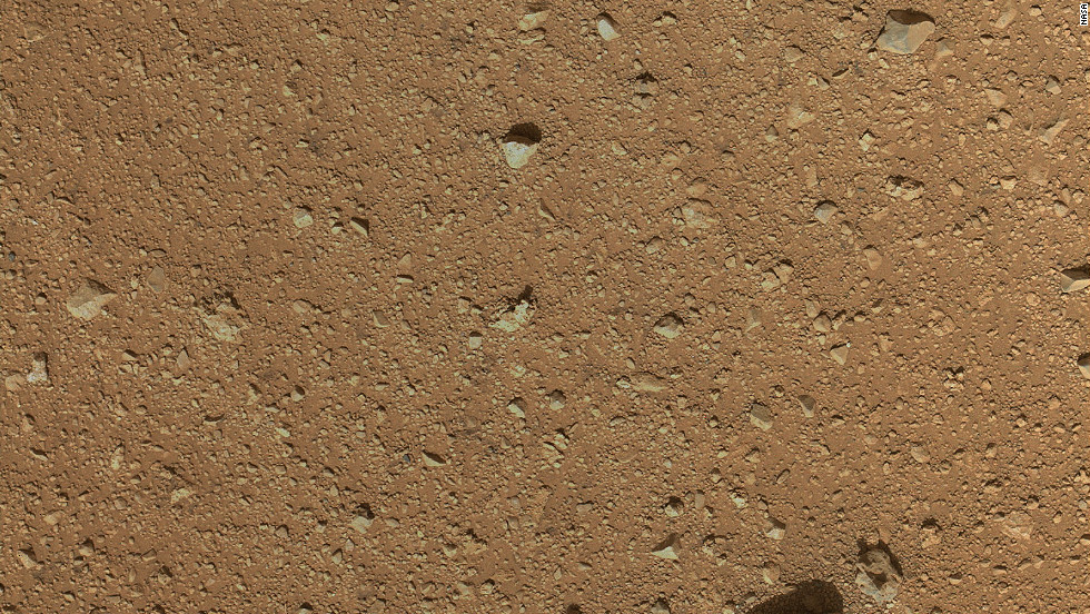 The reclosable dust cover on Curiosity's Mars Hand Lens Imager was opened for the first time on September 8, 2012, enabling MAHLI to take this image.