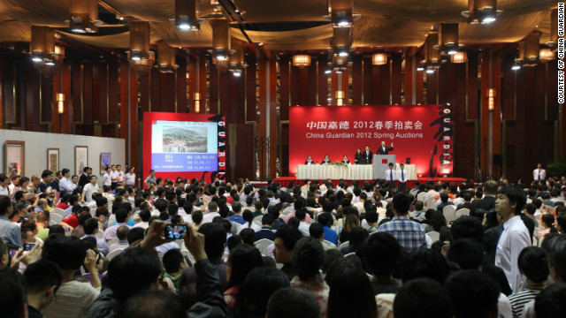 Packed salerooms like this have helped China Guardian become the world's fourth largest auction house