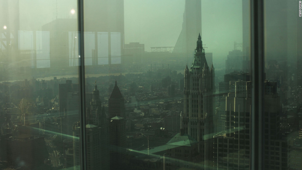 New York City is seen through a window of Four World Trade Center on Friday.