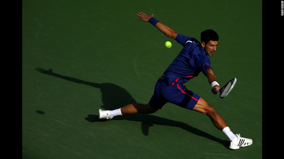 Novak Djokovic of Serbia returns a shot on Monday.