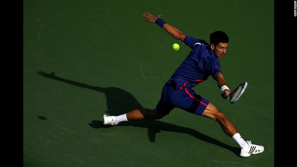 Novak Djokovic of Serbia returns a shot on Monday.