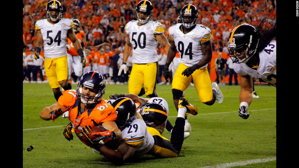 No. 87 Eric Decker of the Denver Broncos makes a 17-yard reception as No. 29 Ryan Mundy and No. 23 Keenan Lewis of the Pittsburgh Steelers make the tackle. The Broncos defeated the Steelers 31-19 on Sunday, September 9.