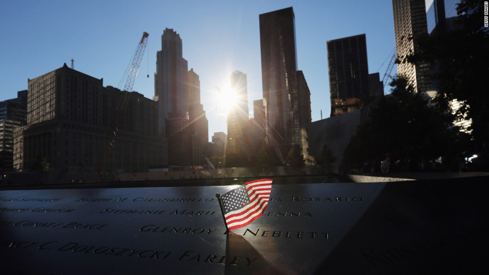 A flag sits in a name on the 9/11 Memorial on Monday.