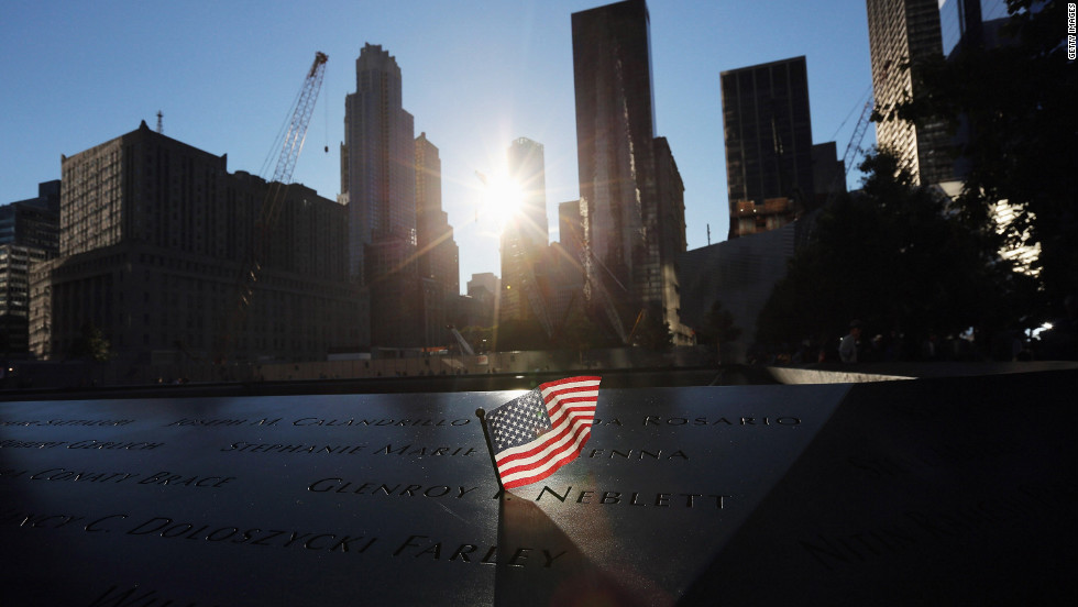 A flag sits in a name on the 9/11 Memorial on September 11, 2012, before ceremonies marking the 11th anniversary of the terrorist attacks begin.