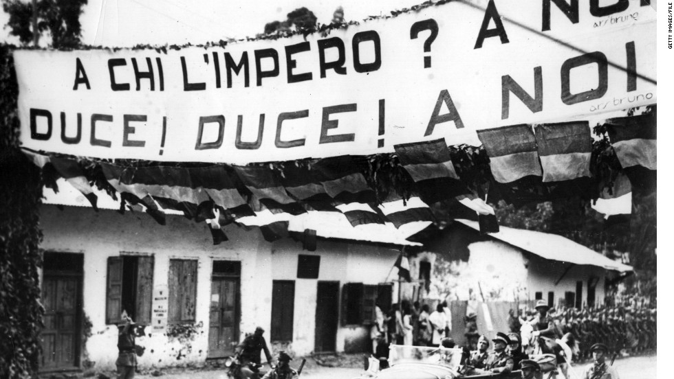 "Despite an emotional appeal by Ethiopian emperor Haile Selassie, the League of Nations lifts sanctions against Italy on July 4, 1936. A banner in Italian-occupied Addis Ababa, pictured, reads: ""To whom does the empire belong? Duce! Duce! To ourselves!"""