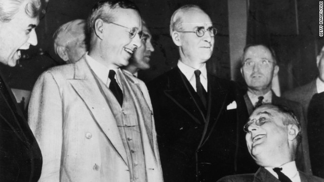 U.S. President Franklin Delano Roosevelt, seated at right, is re-elected on November 3, 1936, in a landslide victory over Kansas Governor Alfred Landon, pictured greeting him..