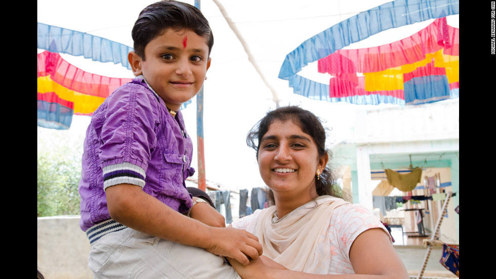 Bhavna Khambhalya, who will wed Kalar, poses with her nephew, Alpesh, on the day before her wedding. Nonfamily wedding guests were told that she is 18 years old, the legal age in India, but her age is not easily verified. Child marriage is still practiced in Maldhari communities, but is gradually declining, said Neeta Pandya, founder of the Maldhari Rural Action Group, a grass-roots empowerment organization.
