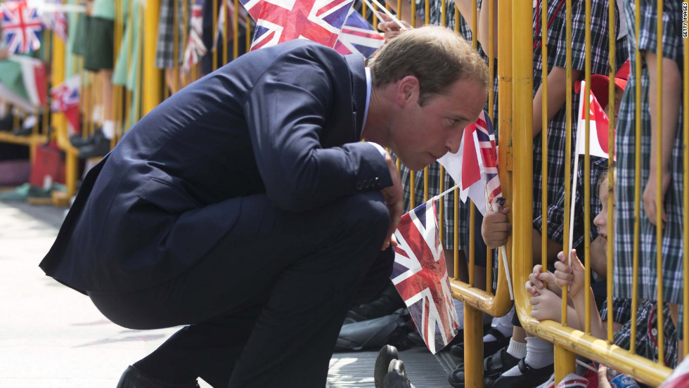 Prince William speaks to a child in the crowd on Wednesday.