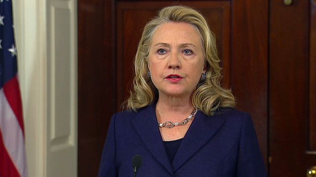 Clinton blames 'small, savage group'