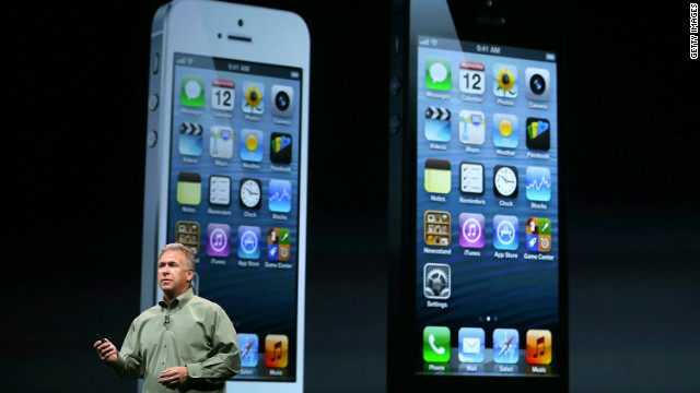 Apple marketing chief Phil Schiller with a slide showing black and white models of the new iPhone 5.