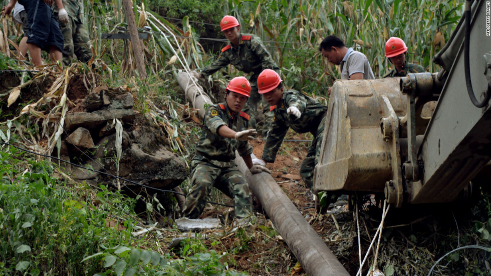 Chinese soldiers from an engineering unit shout a warning when displacing rocks on Monday.