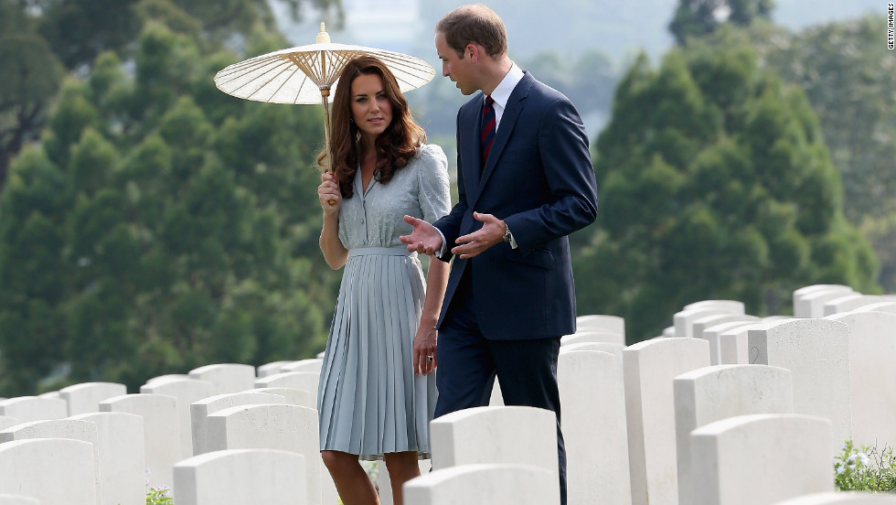 Catherine, Duchess of Cambridge, and Prince William, Duke of Cambridge, visit Kranji War Cemetery Thursday in Singapore.