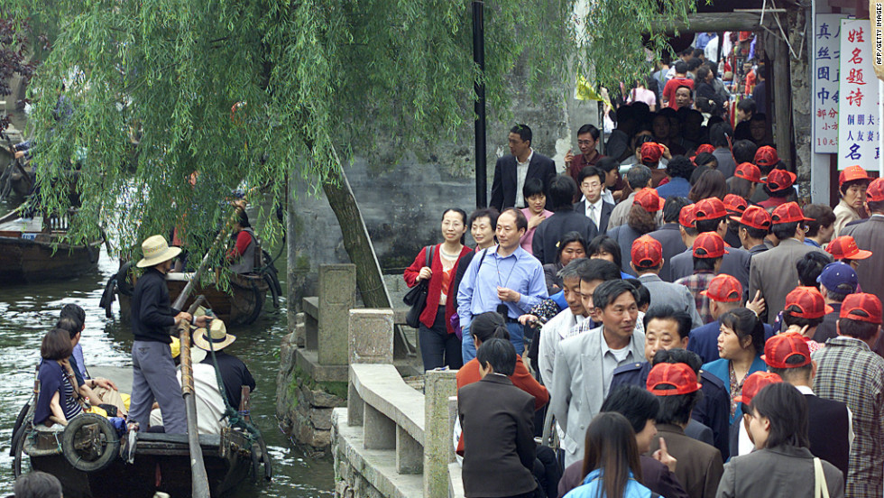 Then follow many of China's own tourists to the water village of Zhou Zhuang.