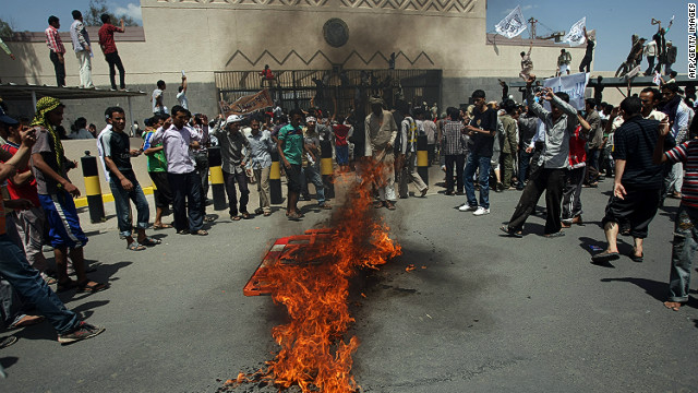 Yemeni protesters gather around fire during a demonstration outside the US embassy in Sanaa over a film mocking Islam on September 13, 2012.