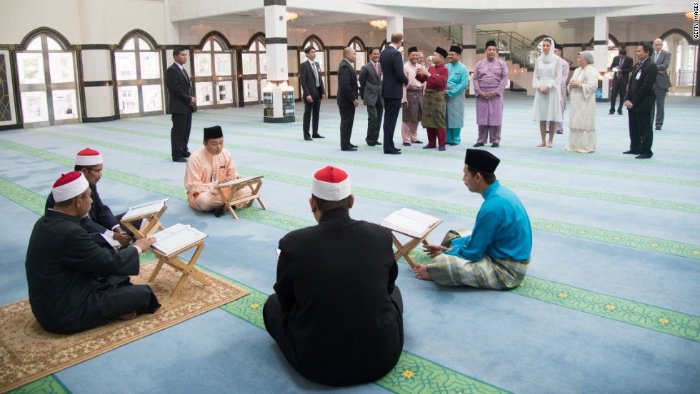 The royal couple visits Assyakirin Mosque in Kuala Lumpur, Malaysia, on Friday.