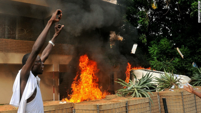 A Sudanese demonstrator shouts slogans after protesters torched the German embassy in Khartoum during a demonstration against a low-budget film mocking Islam on September 14, 2012.