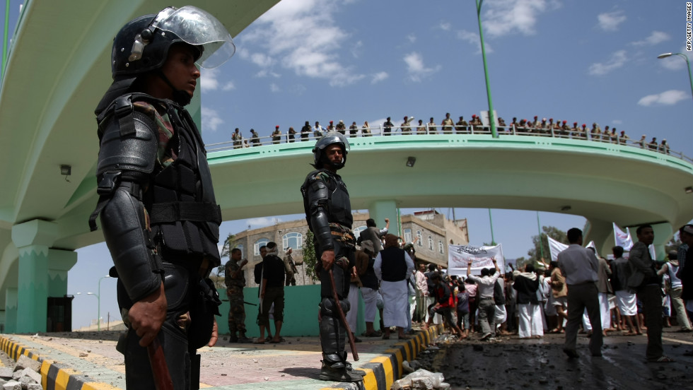Yemeni riot policemen stand guard at a crossroad leading to the U.S. Embassy in Sanaa on Friday.