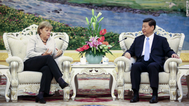 German Chancellor Angela Merkel and Chinese Vice President Xi Jinping talk during their meeting in Beijing on August 30, 2012.
