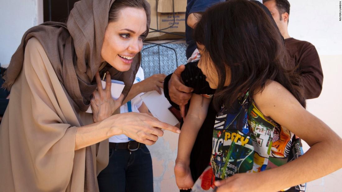 Jolie meets Syrian refugees in Lebanon's Bekaa Valley in September 2012.