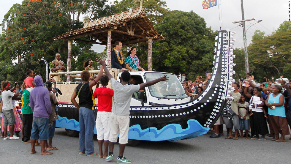 Britain's Prince William and his wife, Catherine, Duchess of Cambridge, are greeted by Solomon Islanders on Sunday.