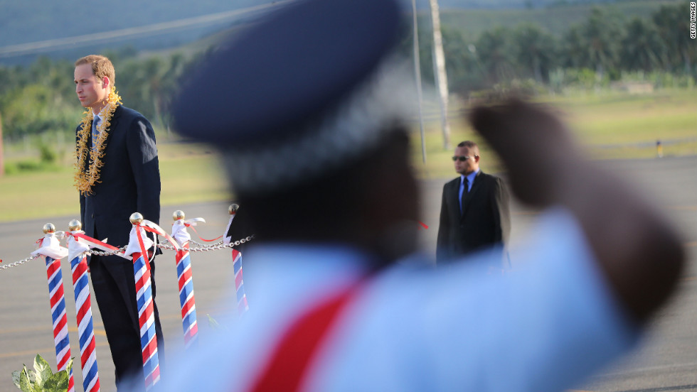 Prince William, Duke of Cambridge, inspects an honor guard as he arrives at Honiara International Airport in the Solomon Islands on Sunday, September 16.