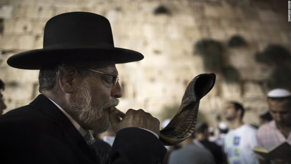 An ultra-Orthodox Jewish man blows a shofar, a ram's horn, as religious Jews participate in the Slichot prayer at the Western Wall on Sunday.