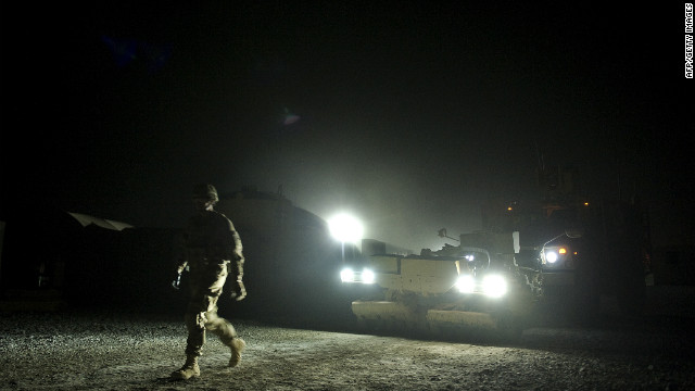 A U.S. army infantryman walks in front of a mine-resistant vehicle at Lindsey Forward Operating Base Saturday in Kandahar.
