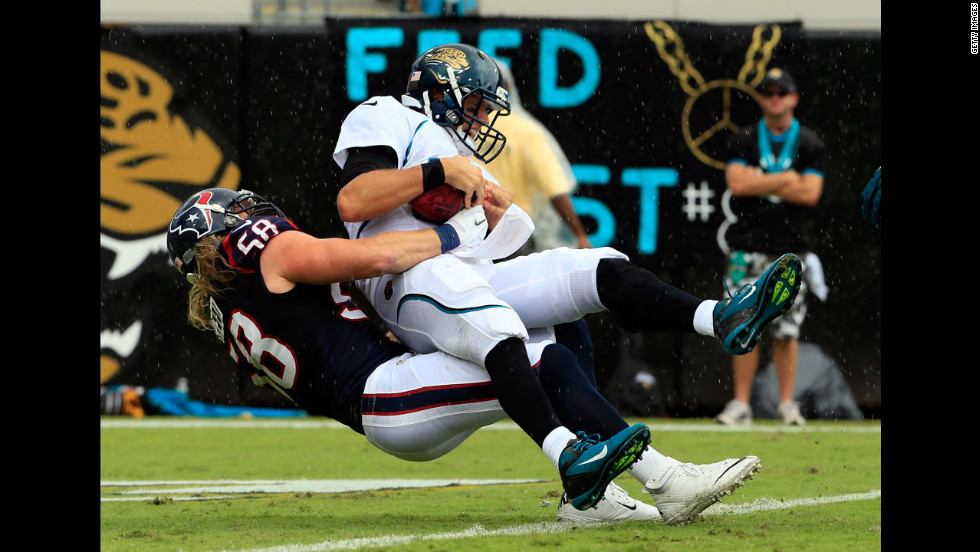 Blaine Gabbert of the Jacksonville Jaguars is sacked by Brooks Reed of the Houston Texans during Sunday's game.