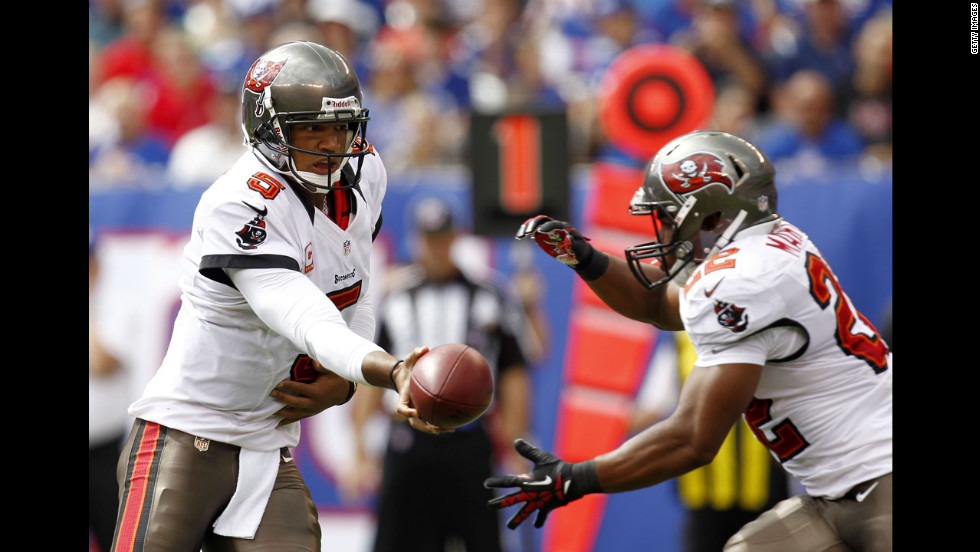 Quarterback Josh Freeman hands off to running back Doug Martin of the Tampa Bay Buccaneers during the game against the New York Giants on Sunday.