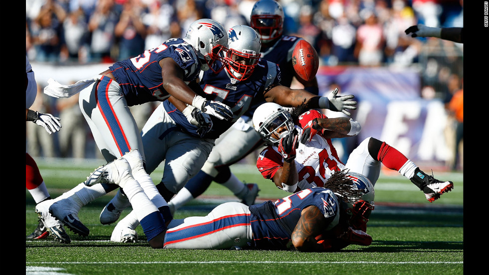 No. 55 Brandon Spikes of the New England Patriots forces a fumble by No. 34 Ryan Williams of the Arizona Cardinals in the fourth quarter Sunday.