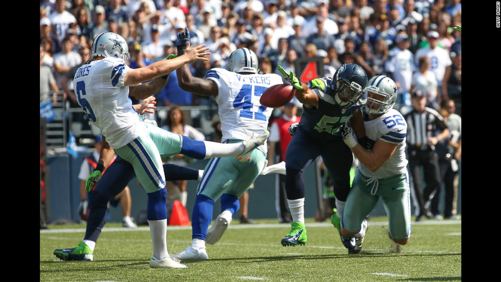 Linebacker Malcolm Smith of the Seattle Seahawks blocks a punt by Chris Jones of the Dallas Cowboys on Sunday.