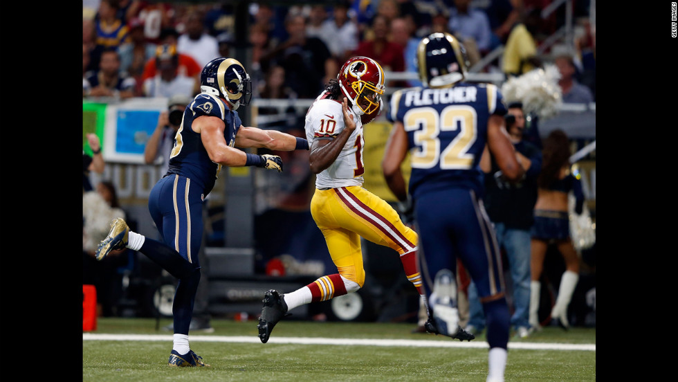 Quarterback Robert Griffin III of the Washington Redskins carries the ball over the goal line for a touchdown during Sunday's game against the St. Louis Rams.