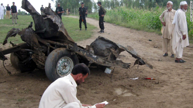 Pakistani security officials work at the site of a bomb blast in Jandol town, in the district of Lower Dir.