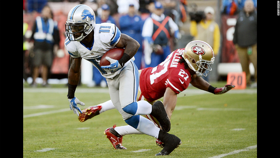 Stefan Logan of the Detroit Lions gets tripped up by C.J. Spillman of the San Francisco 49ers during a punt return on Sunday.