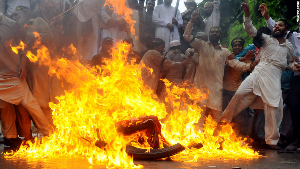 Sunni Muslims burn a U.S. flag during a protest in Lahore, Pakistan, on Monday. Protests entered their second week, with demonstrators taking to the streets in Pakistan, Afghanistan, Indonesia and Lebanon.