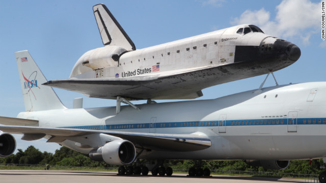 U.S. space shuttle Endeavour's final piggyback flight to California has been delayed due bad weather.