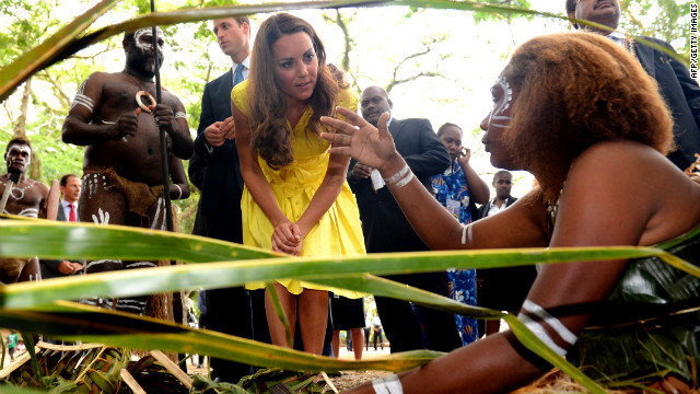 Prince William and his wife Catherine, the Duchess of Cambridge speak with traditional weavers during a visit to a village in Honiara on Monday, September 17.