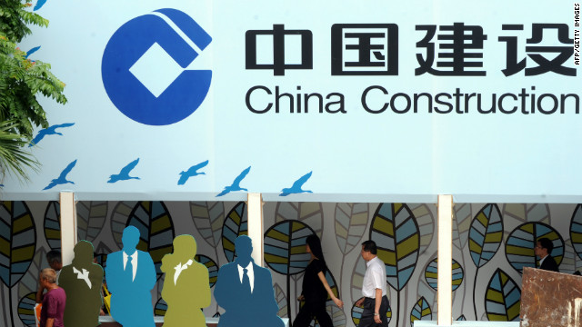 People walk past an advertising for China Construction Bank in Hong Kong.