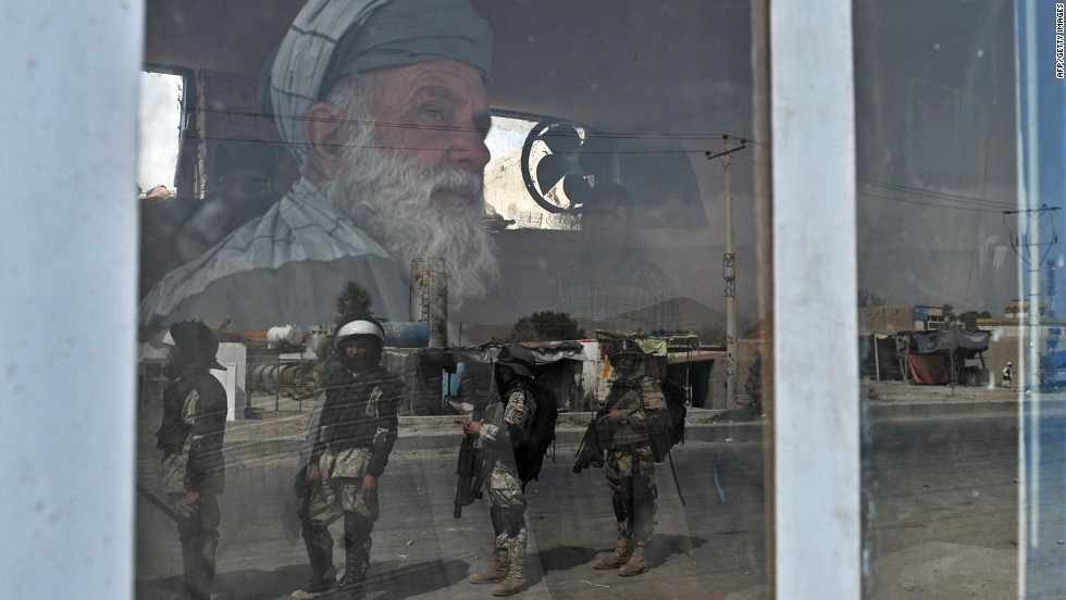 Afghan riot police are reflected through a window during an anti-U.S. protest Monday in Kabul, Afghanistan. Protesters attacked police along a road leading to the U.S. Embassy in Kabul.