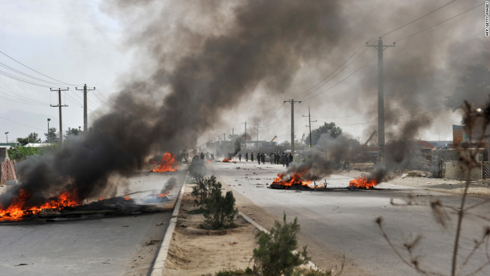 Barricades of tires burn Monday in Kabul.