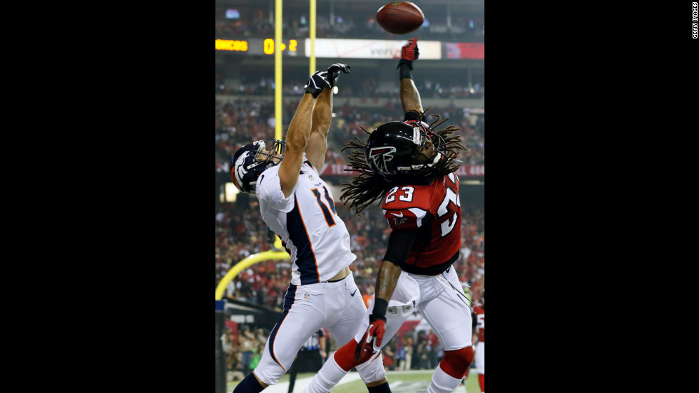 Dunta Robinson of the Atlanta Falcons breaks up a pass intended for Brandon Stokley of the Denver Broncos in the end zone on Monday.