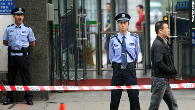 Chinese policemen stand guard outside the Chengdu People's Intermediate in Sichuan province on September 18, 2012.