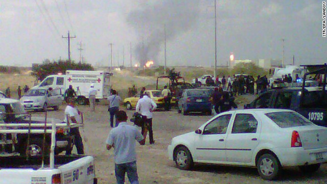 Ambulances and paramedics arrive at the refinery.