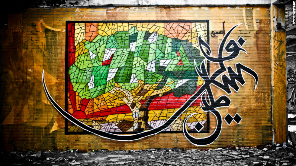 "eL Seed painted his olive tree in Montreal as a symbol of peace throughout the Mediterranean and the identity of the Palestinian culture. The mural is called ""My Name is Palestine."""