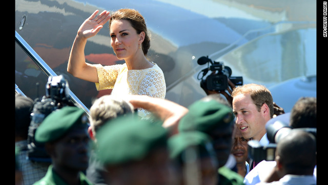 Catherine (L), the Duchess of Cambridge, waves farewell as she and her husband Prince William (bottom R) leave the Solomon Islands from Honiara on September 18, 2012.  The royal couple are on a nine-day tour marking Queen Elizabeth II's Diamond Jubilee, and have already visited Singapore and Malaysia and the Solomon Islands as they head to Tuvalu.     AFP PHOTO / William WEST        (Photo credit should read WILLIAM WEST/AFP/GettyImages)