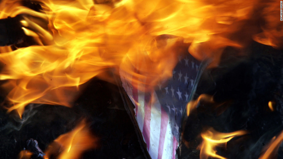 "Indian Muslims burn an American flag with a picture of U.S. President Barack Obama as they protest against a U.S.-made anti-Islam film on Tuesday, September 18, near the U.S. Consulate in Chennai. About 5,000 people have gathered in front of the building. Google India has already blocked access to the film, which the government has condemned as ""offensive."""