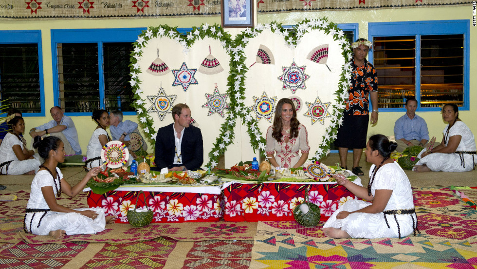 The couple enjoy a traditional dinner at Tausoa Lima Falekaupule on Tuesday in Tuvalu.