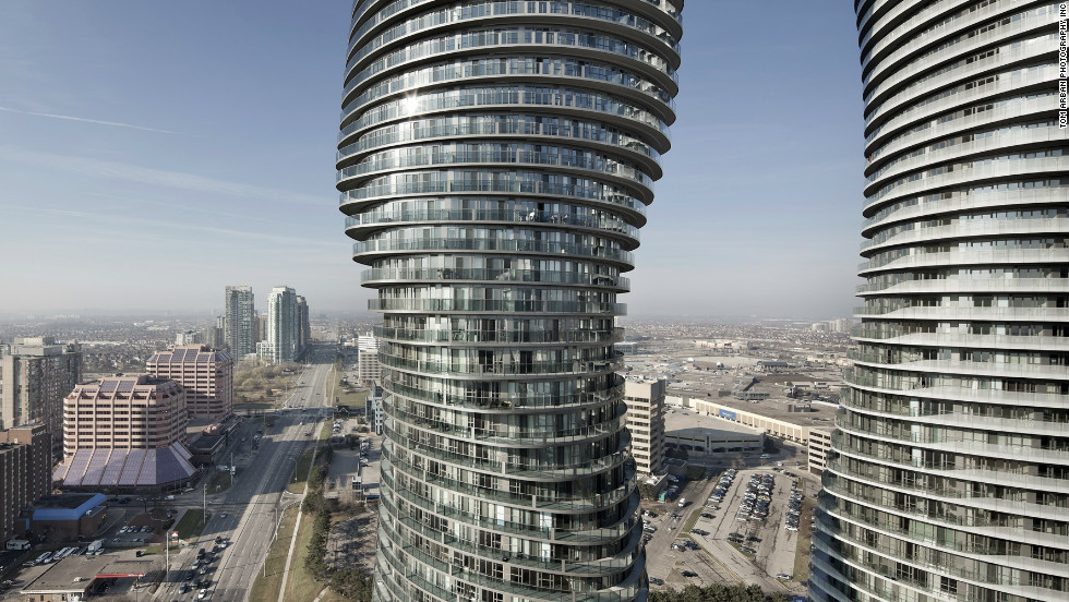 Beijing architect Ma Yansong designed the Absolute Towers that have enlivened the city of  Mississauga in Canada. A continual balcony spirals up the building's sinuous exterior, and every floor is different.