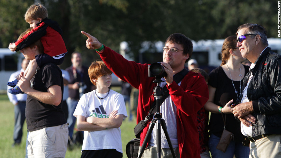 Spectators wait for Endeavour to fly over Hancock County, Mississippi, on Wednesday.