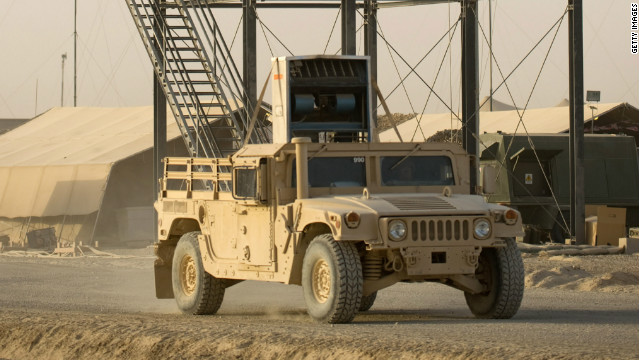 An armoured vehicle passes a watchtower at Bastion Airfield at Camp Bastion on December 7, 2010 in Helmand Province, Afghanistan.